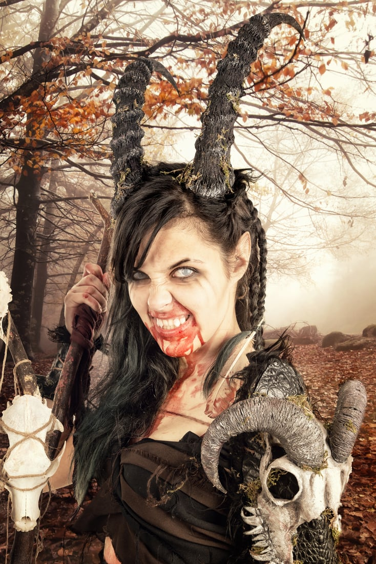 Faun sorceress with big horns in a forest original halloween costume