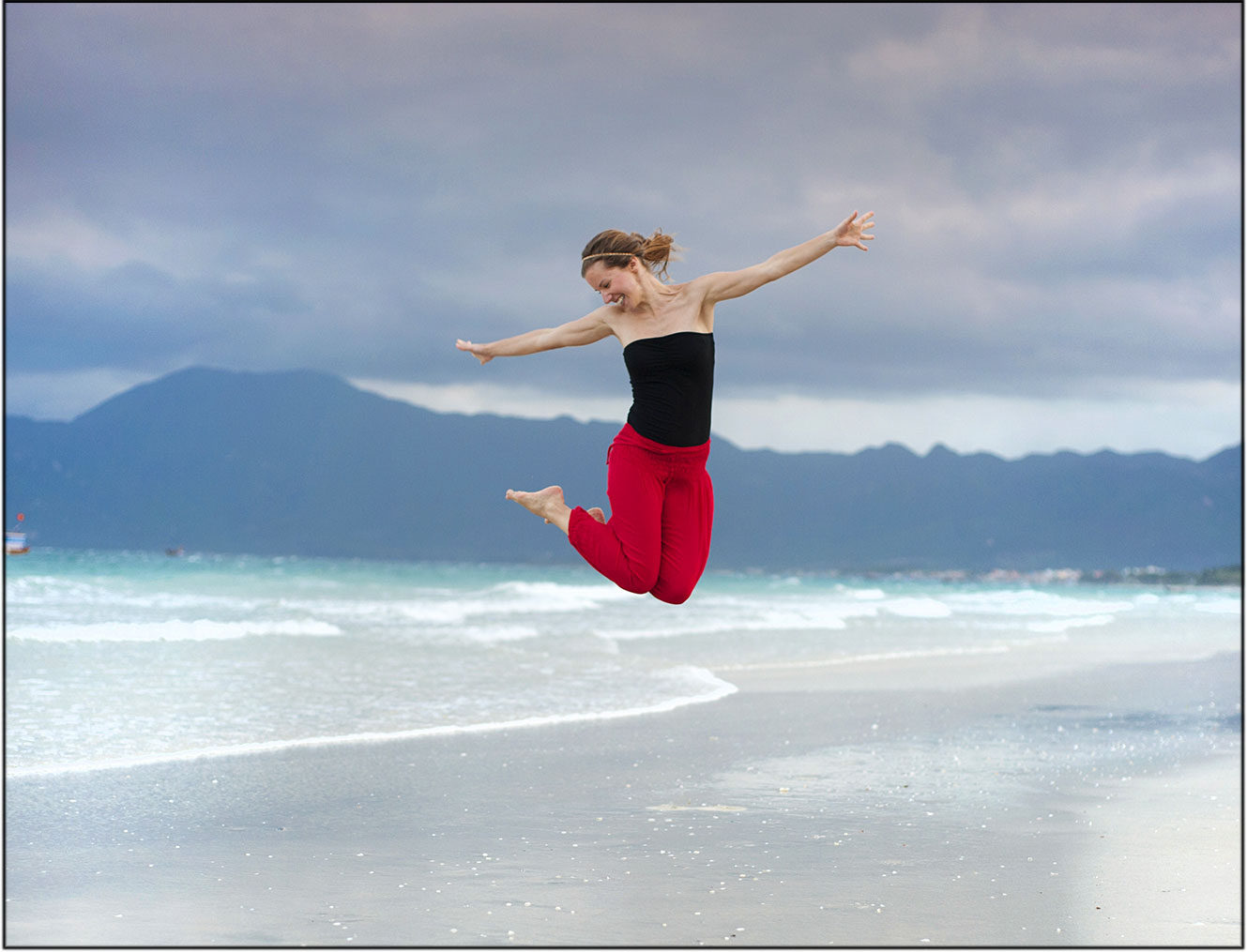 woman jumping with happiness