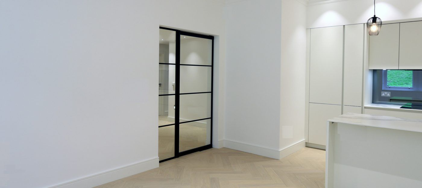 steel framed pivoting door to interior design