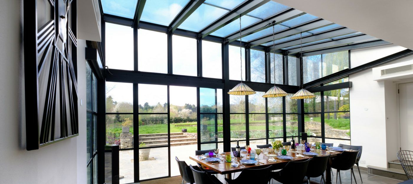 steel framed glass extension with glass roof