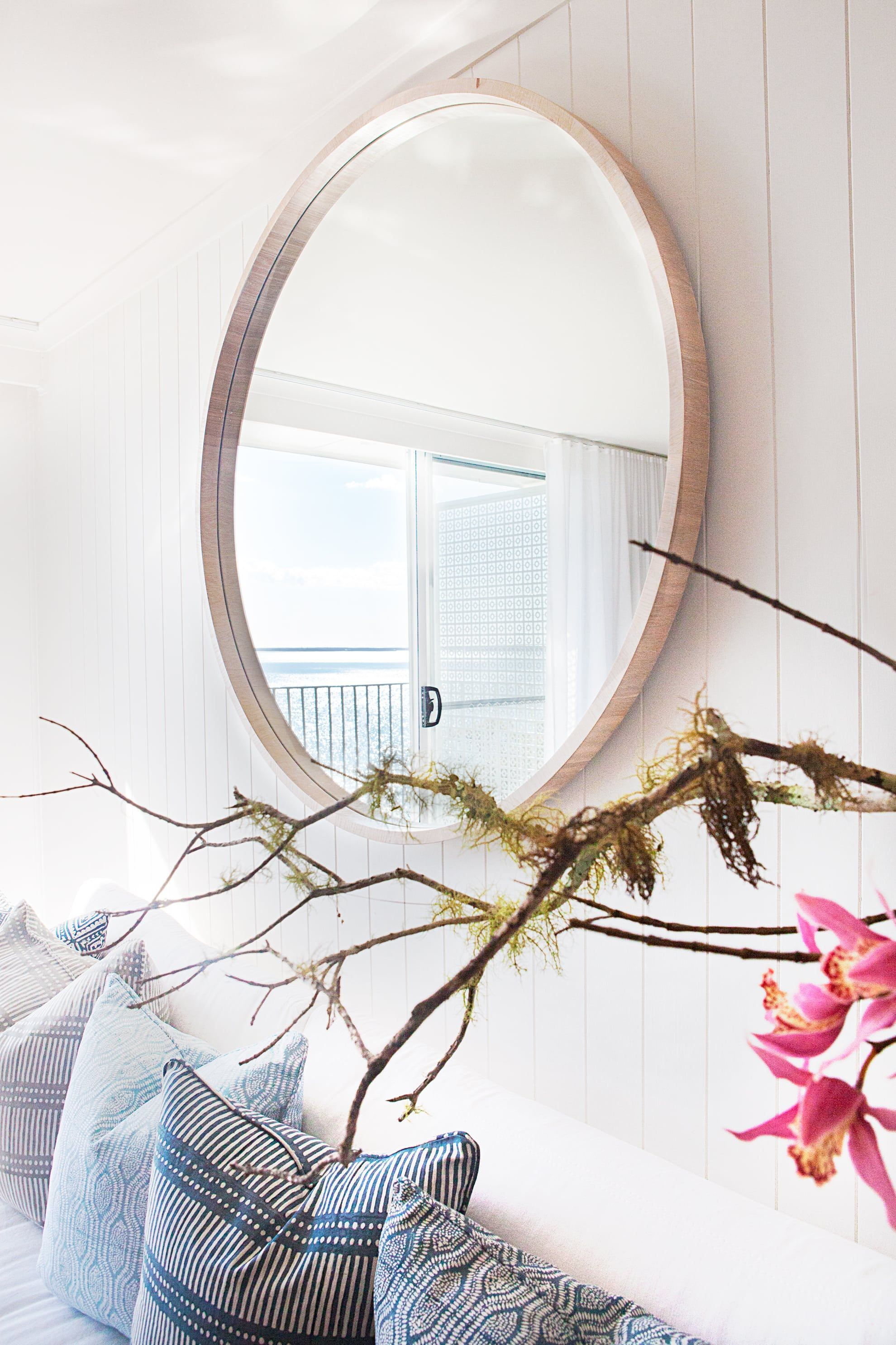Large mirror reflects view of ocean outside
