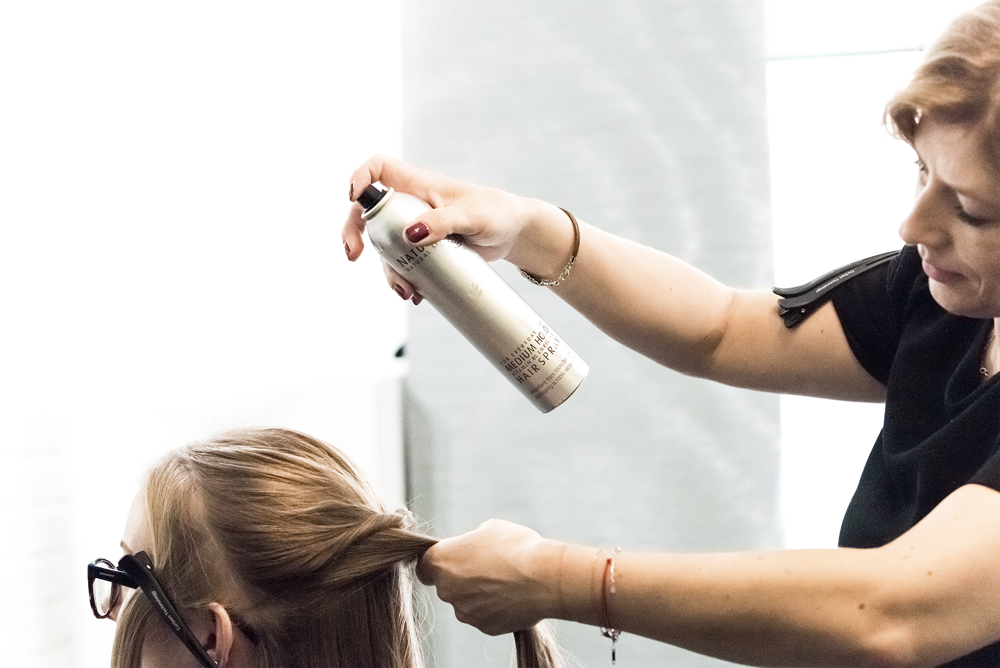 Salon hair final styling with spray