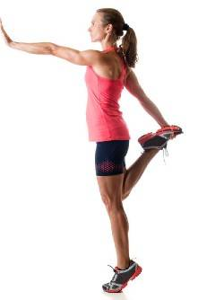 A woman doing a single leg calf raise