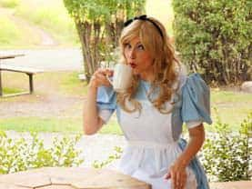 Alice sipping tea from a cup