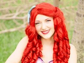 Mermaid Princess with her red hair loves seashells and sea life and parties under the sea