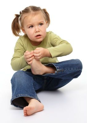 A little girl with a sore foot