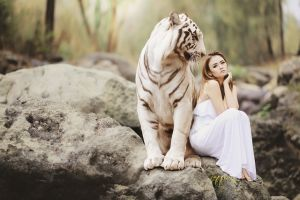 a woman with a powerful tiger