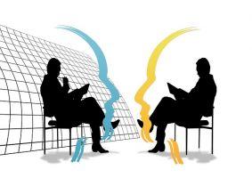 2 men negotiating