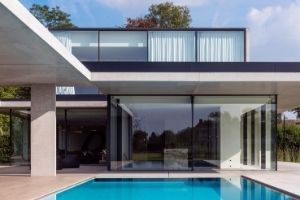 automated sliding glass door - minimal windows oversized glazing