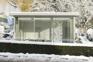 glass box garden room with heated sliding glass doors to prevent show build up and keep the glass box warm
