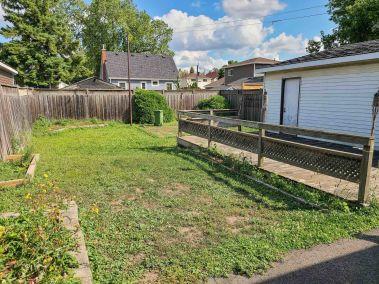 33. 65 East 38th Street - Fully Fenced Yard