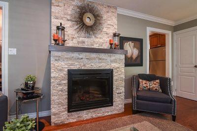 7. 200 Appleford Court Hamilton - Living Room Fireplace View