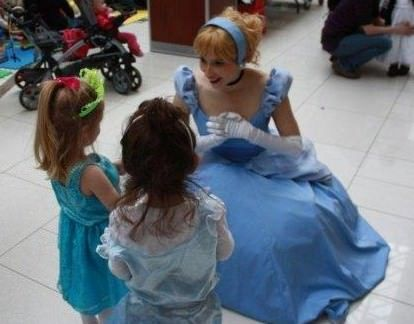 Cinderella chatting with excited princesses at Calgary mall Kids' event