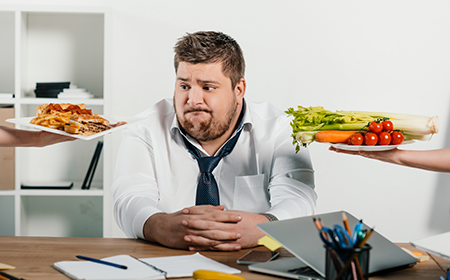 man making choice between dishes