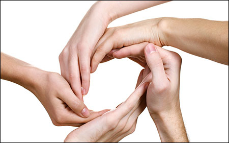circle of hands showing human connection