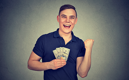 image of man holding money he saved from making sales