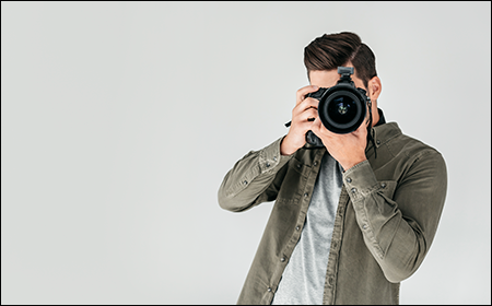 image of photographer looking down the lens