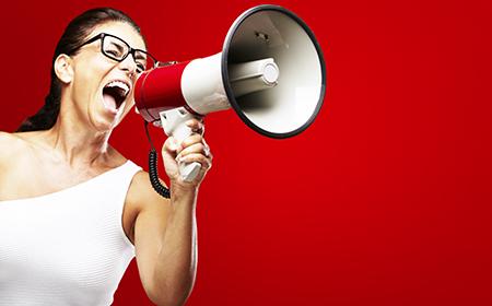 Woman providing information through a loudspeaker