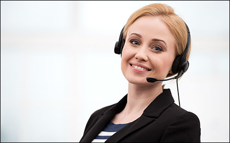 Smiling receptionist providing information to customer