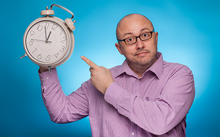 Man with clock showing little time left for people to buy photos