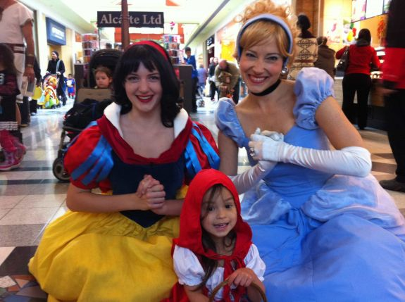 Princess Snow White and Princess Cinderella posing with the famous Little Red Riding Hood at Northland Village Mall Halloween Celebration