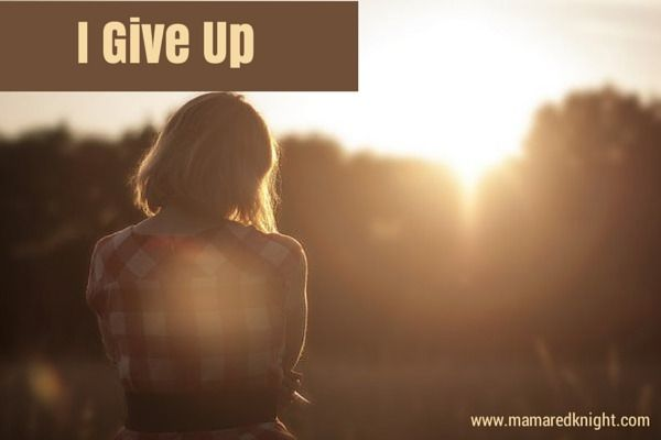 "Sepia toned image with light haired woman, head bowed, looking at the sun over a treeline, with the words ""I Give Up"" on top"