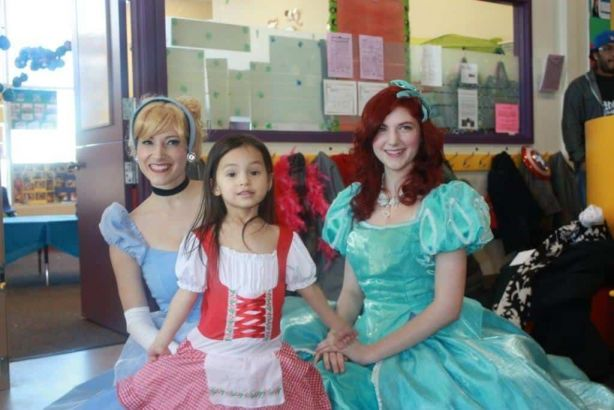 Princess Cinderella and Princess Little Mermaid posing with birthday girl
