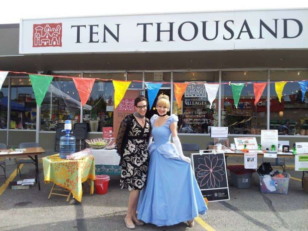 Princess Cinderella with the fair trade food display outside Ten Thousand Villages Calgary