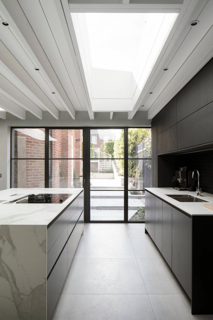 Modern kitchen with steel patio doors and rooflight