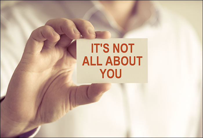 sign saying 'It's not all about you'