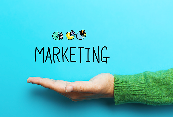 image displaying the word marketing with hand underneath