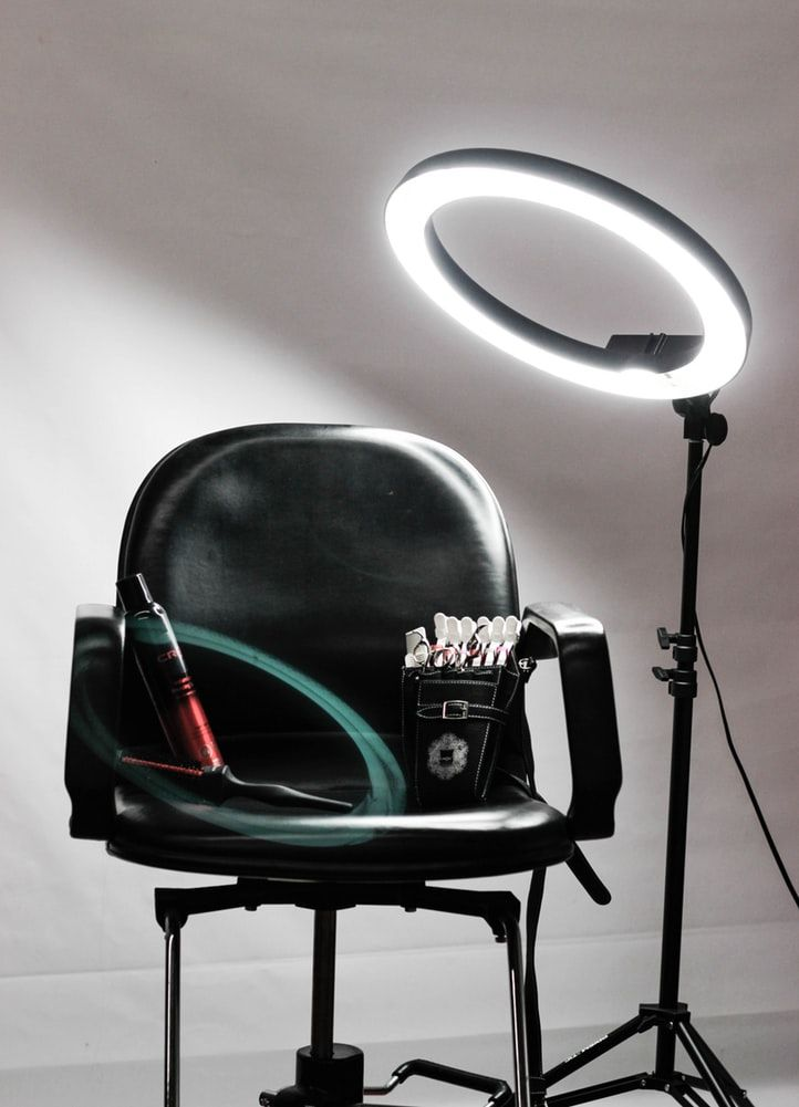 a ring light and hair salon chair set up for a photo session