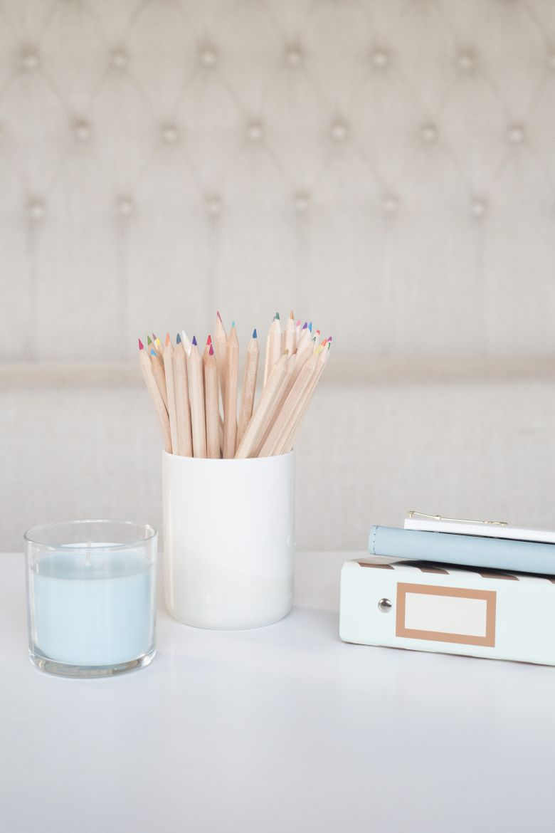 Binder, cup and candle image