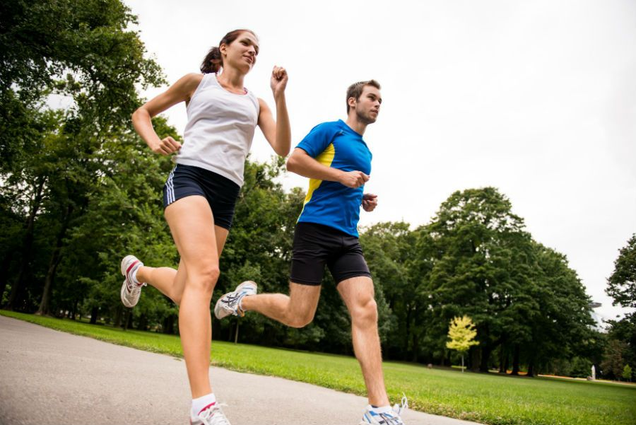 A man and a woman running downhill